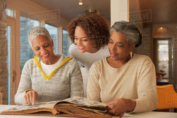 Women looking at family photo album Royalty-free stock photo