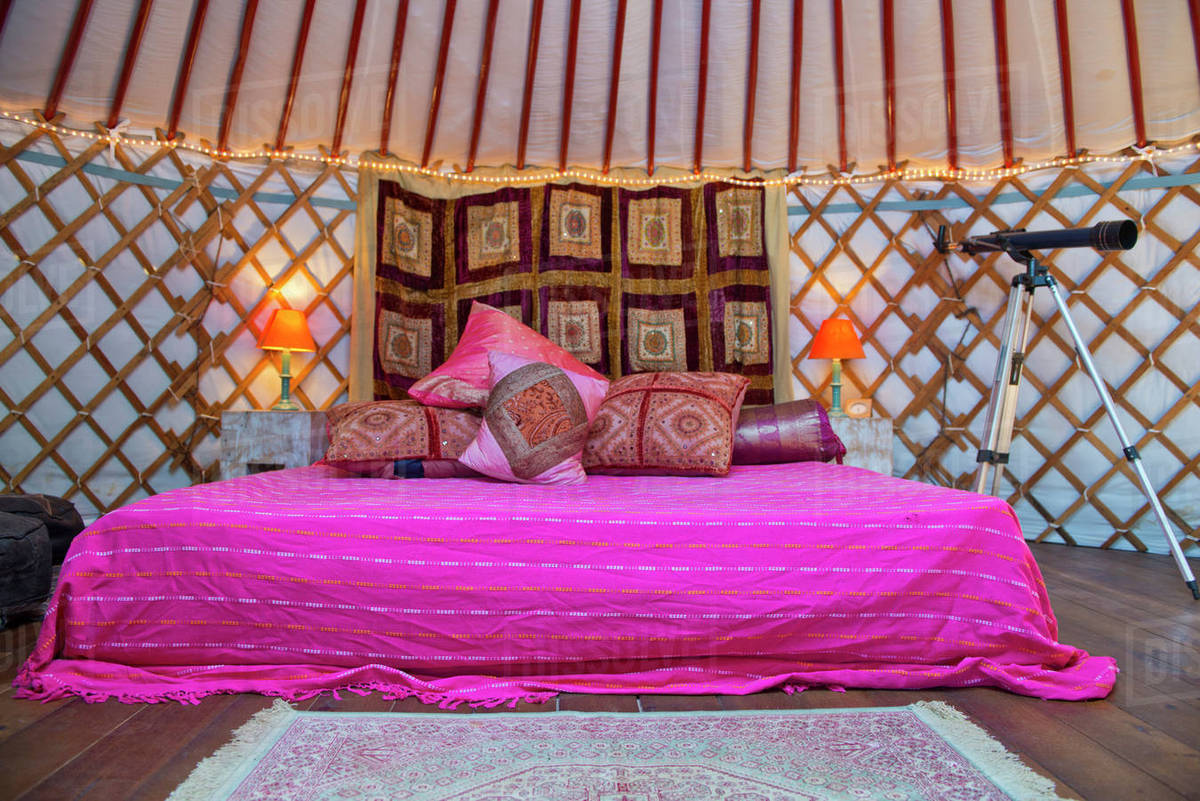 King Size Bed With Bright Colors Pillows And Telescope Inside A Mongolian Yurt Andalucia Spain Stock Photo Dissolve