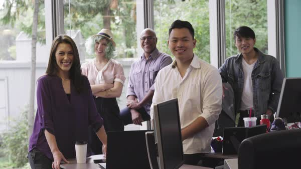Portrait of smiling business people posing in casual office Royalty-free stock video