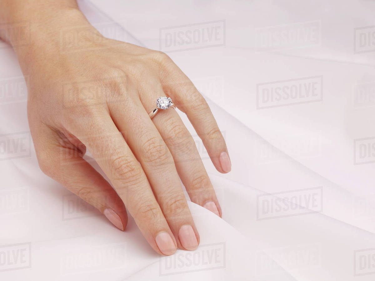 Hand Of Woman Wearing Engagement Ring Stock Photo