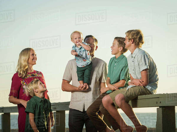 Caucasian family  watching baby boy stand on hands of father Royalty-free stock photo