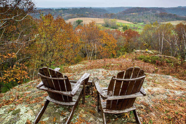 Adirondack chairs in rolling landscape Royalty-free stock photo