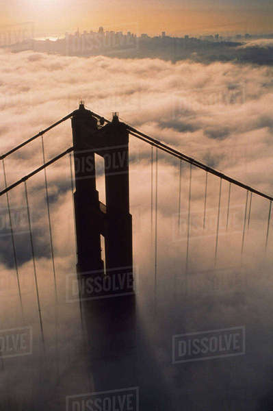 Aerial view of bridge over fog at sunset Royalty-free stock photo