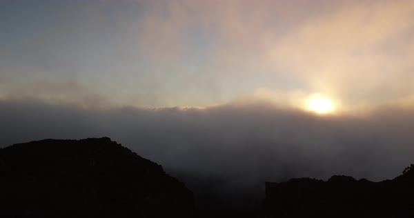 Sunrise over thick clouds on top of Haleakala Crater Royalty-free stock video