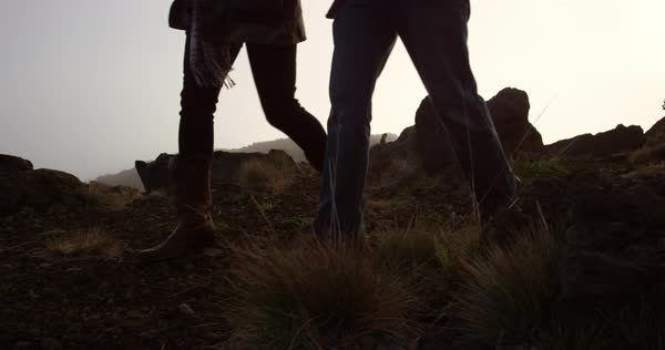 Couple walking side by side on top of Haleakala Crater Royalty-free stock video