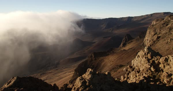 Clouds hovering in Haleakala Crater at sunrise Royalty-free stock video