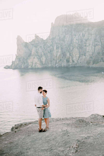 Caucasian man hugging woman at beach Royalty-free stock photo