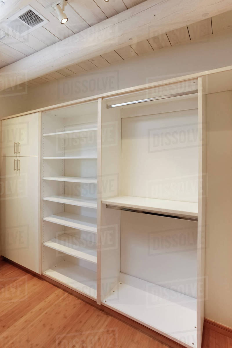 empty walk in closet. Cabinets And Empty Shelves In Walk-in Closet Walk A