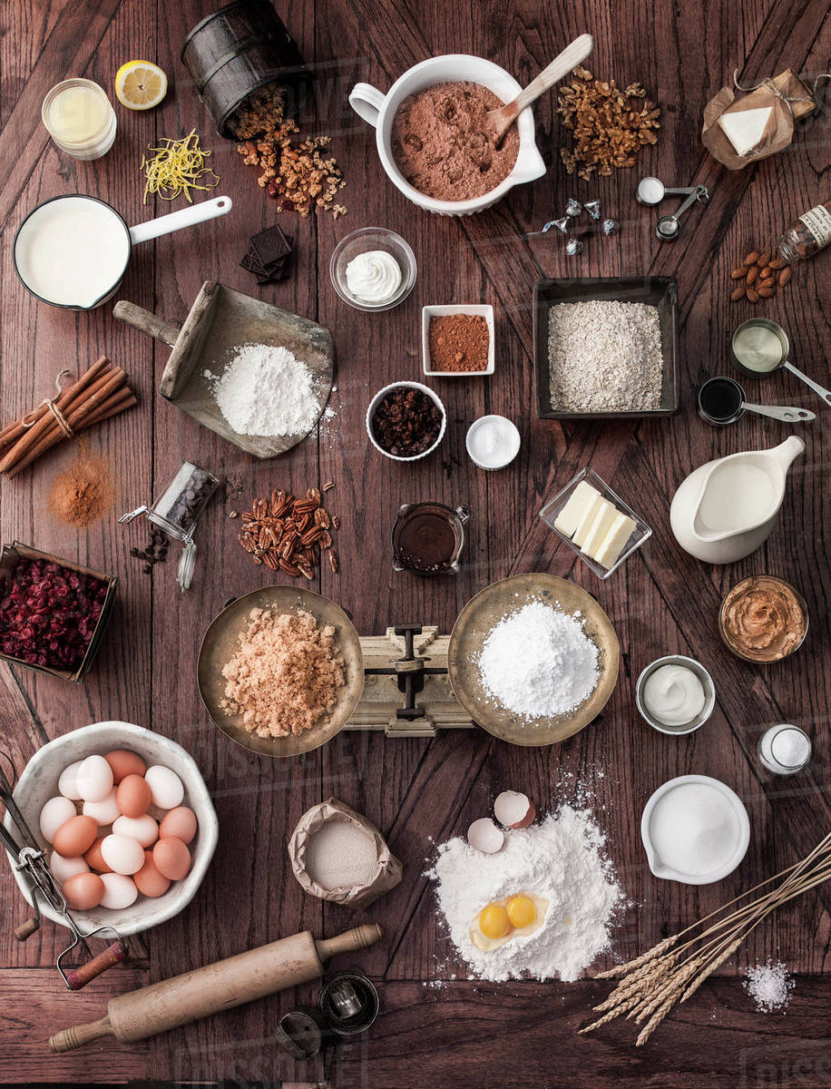 Scale and baking ingredients on wooden table stock photo