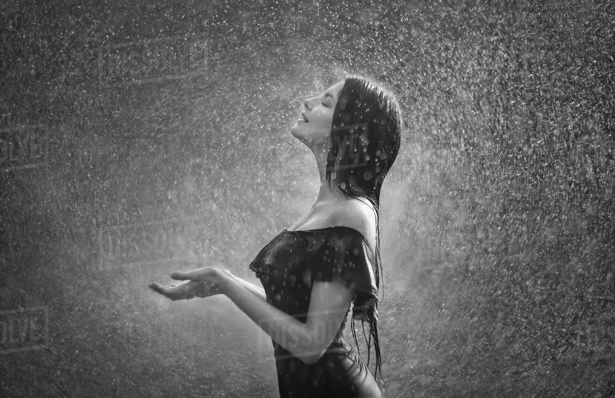 women-standing-in-the-rain image - Free stock photo