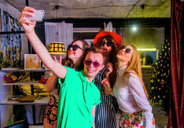 Fashionable friends posing for cell phone selfie Royalty-free stock photo