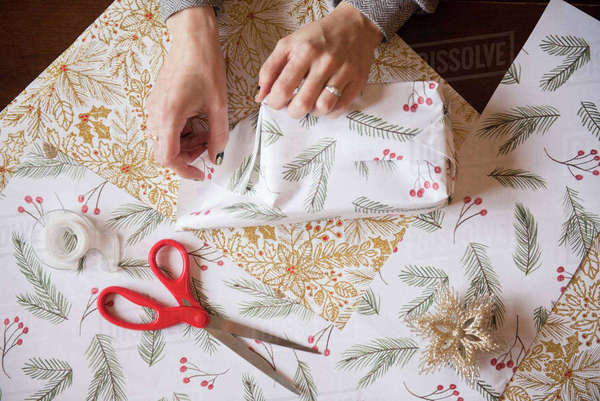 Hands of woman wrapping Christmas gifts Royalty-free stock photo