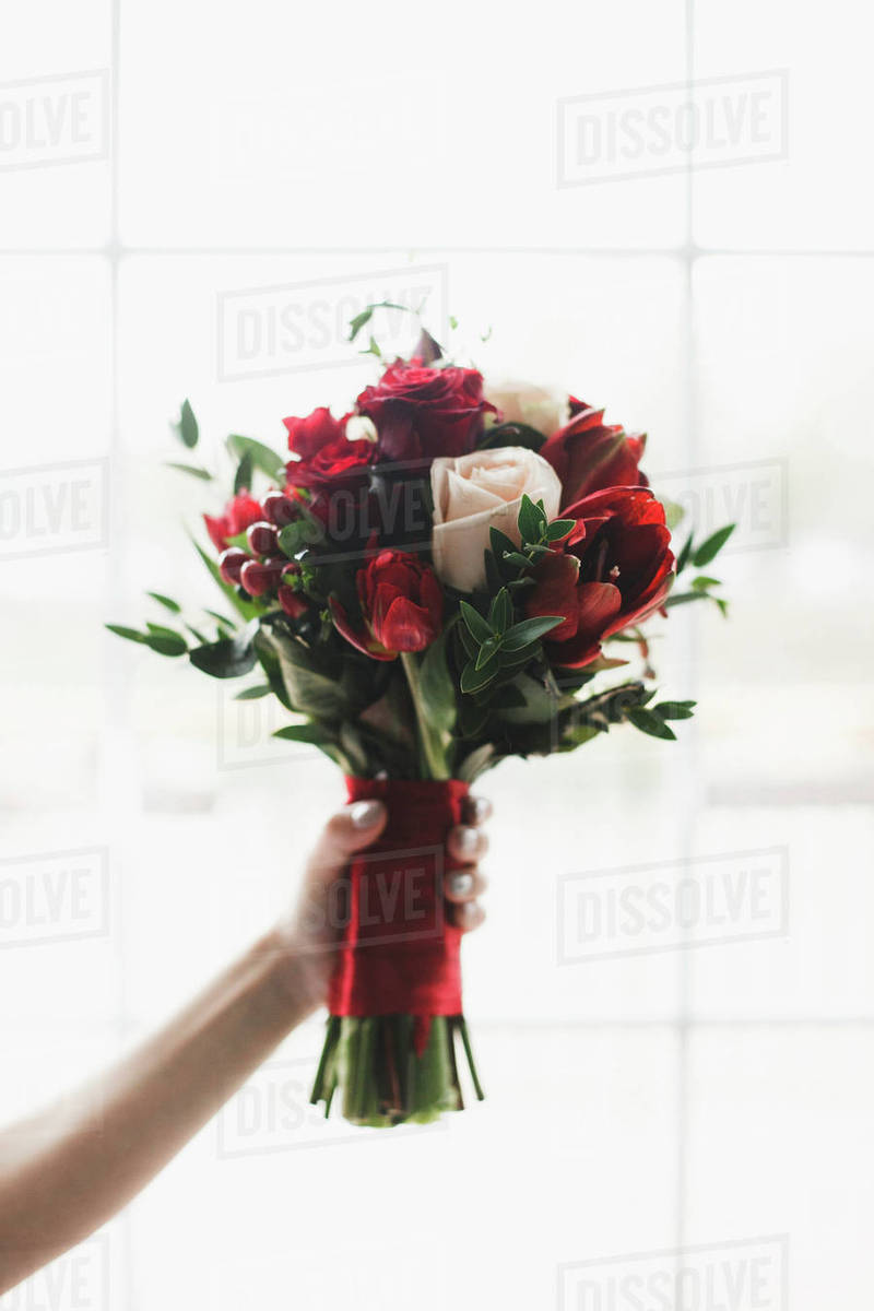 Hand Of Woman Holding Bouquet Of Flowers Stock Photo Dissolve