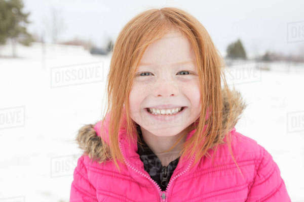 Portrait of smiling girl in winter Royalty-free stock photo
