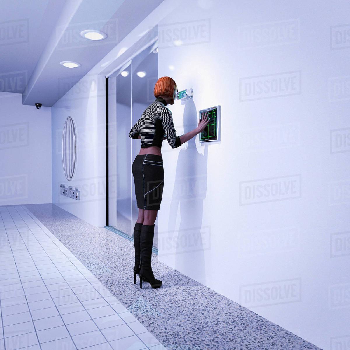 Woman using biometric scanners in futuristic corridor stock photo