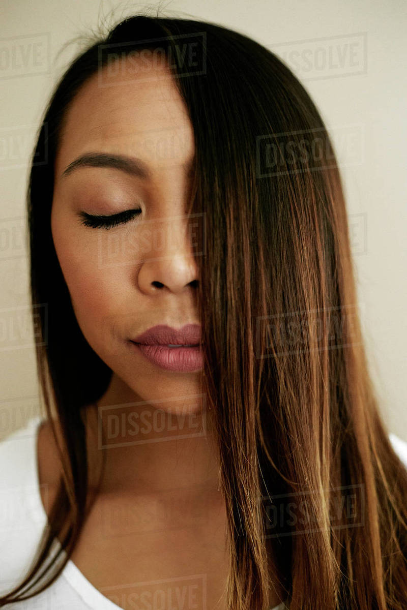 Hair Of Asian Woman Covering Half Of Face Stock Photo Dissolve