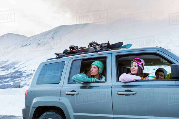 Women looking from car windows in winter Royalty-free stock photo