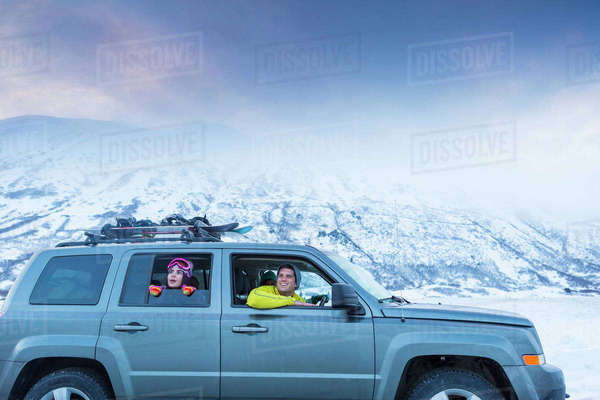 Friends looking from car window in winter Royalty-free stock photo