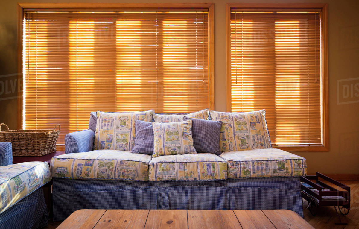Wood Blinds Behind Sofa In Living Room Stock Photo Dissolve