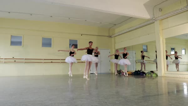 Slow motion shot of ballerinas performing split leap Royalty-free stock video