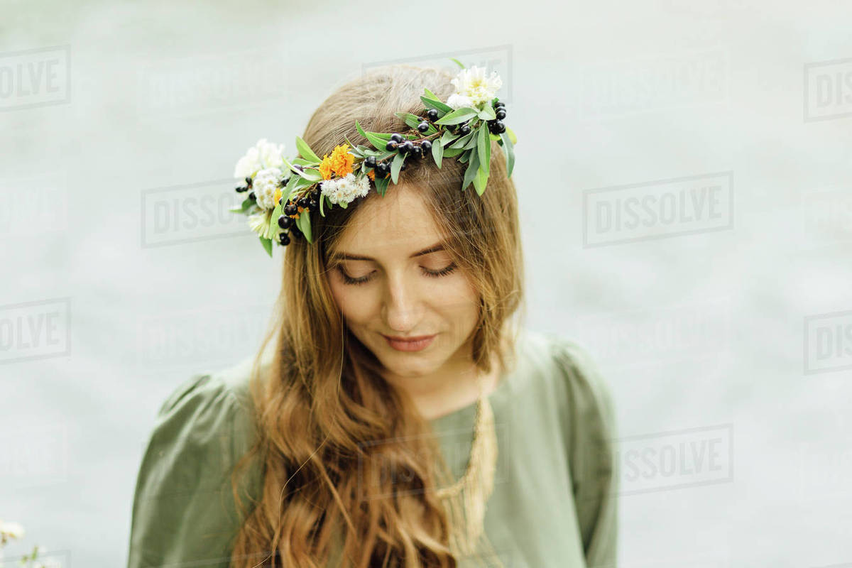 Middle Eastern Woman Wearing Flower Crown Looking Down Stock Photo