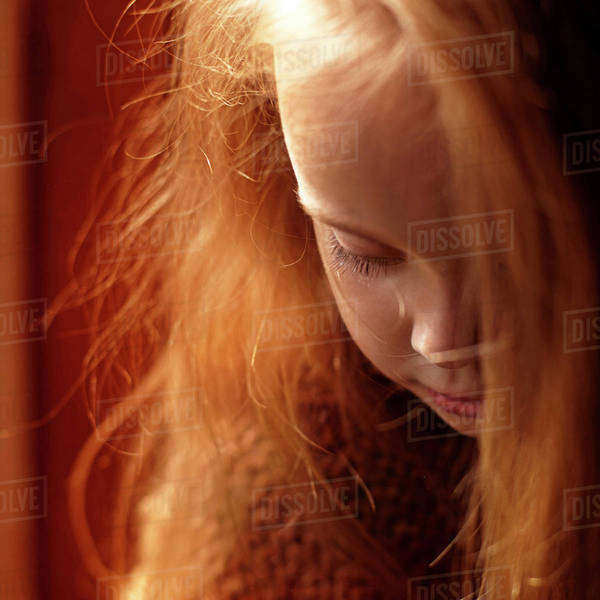 Close up of Caucasian girl looking down Royalty-free stock photo