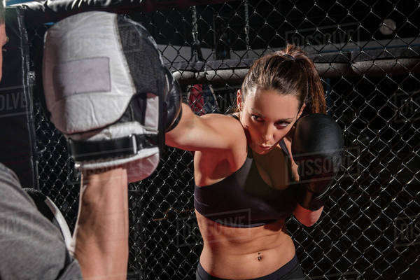 Caucasian fighter working with trainer in gym Royalty-free stock photo