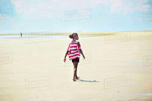 Black girl walking on beach Royalty-free stock photo