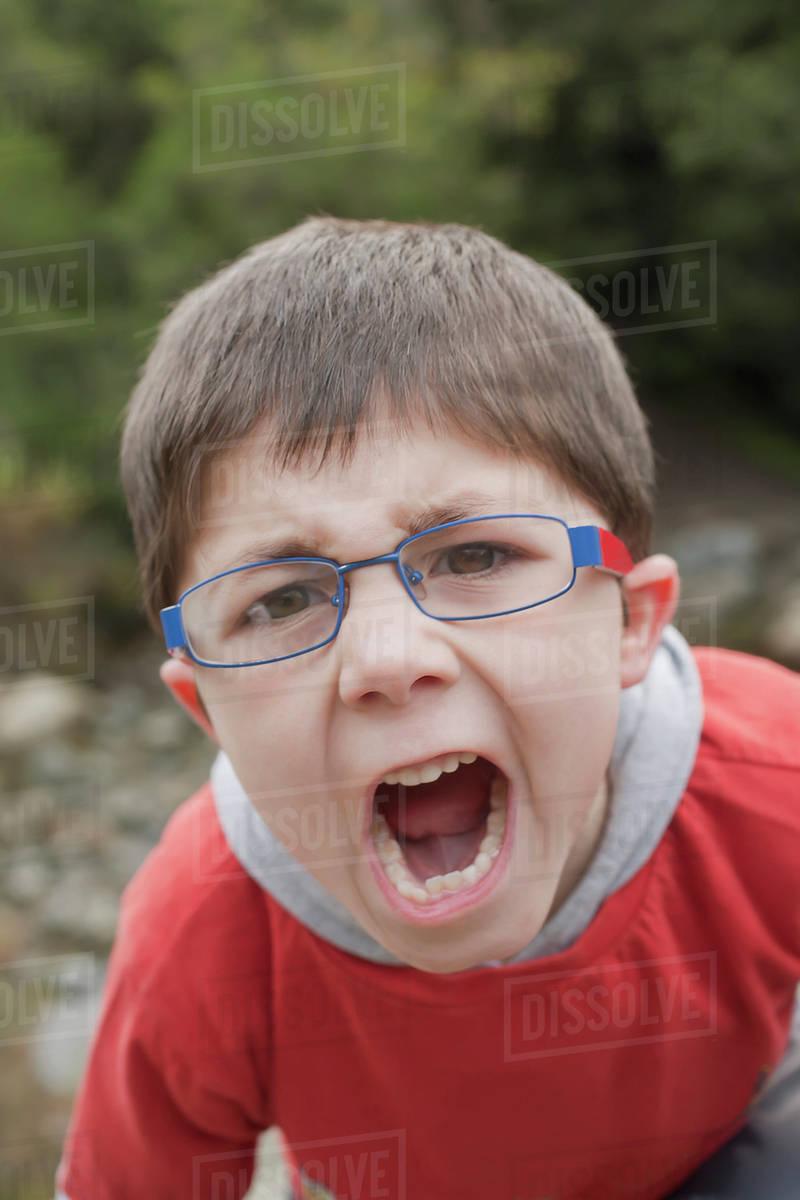 hispanic boy screaming outdoors stock photo dissolve