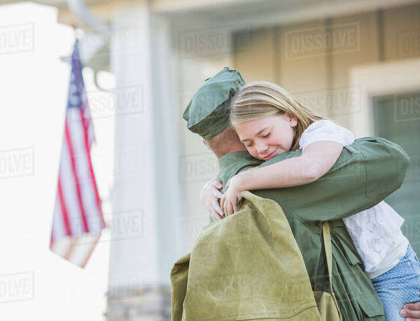 Returning Caucasian soldier hugging daughter Royalty-free stock photo