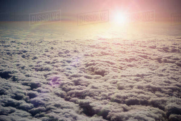 Sun shining in sky above clouds Royalty-free stock photo