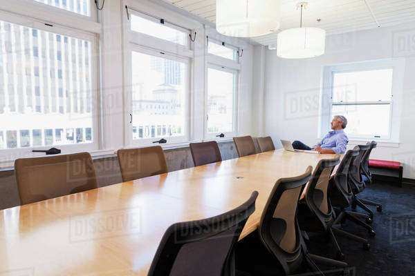 Businessman sitting at table in conference room Royalty-free stock photo