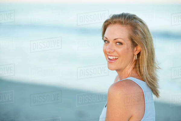 Caucasian woman smiling on beach Royalty-free stock photo