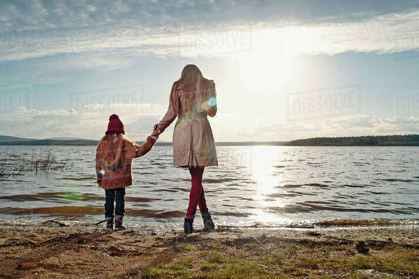 Caucasian mother and daughter standing on beach Royalty-free stock photo