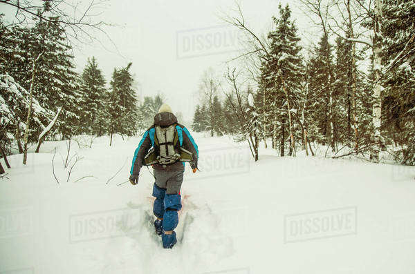 Caucasian hiker walking in deep snow Royalty-free stock photo