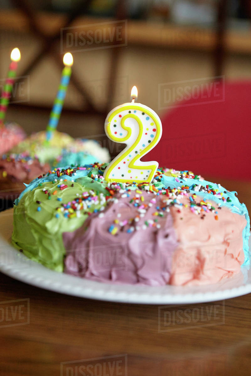 Enjoyable Close Up Of Birthday Cake With Number Two Candle Stock Photo Birthday Cards Printable Trancafe Filternl