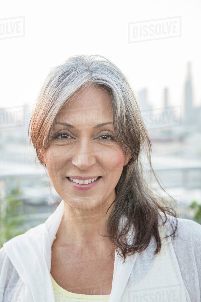 Older Mixed Race Woman Smiling Stock Photo Dissolve