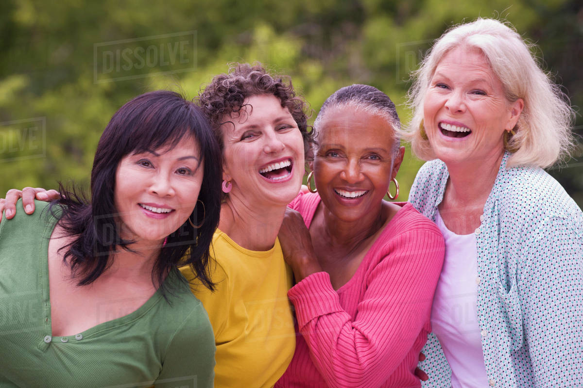 older women walking together outdoors - stock photo - dissolve