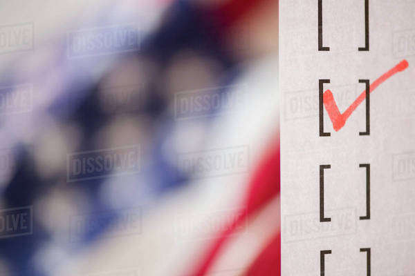 Close up of voting ballot near American flag Royalty-free stock photo