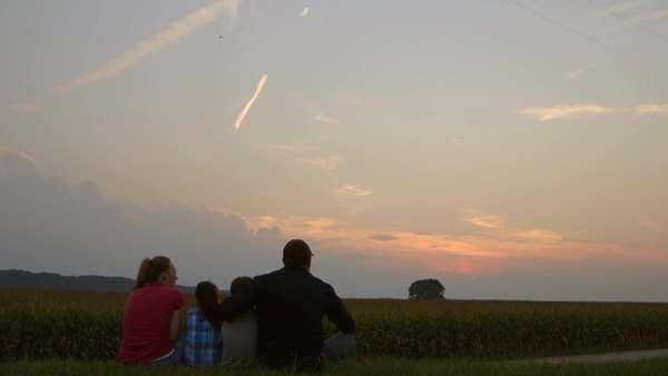 Caucasian watching sunset over crops at dusk Royalty-free stock video