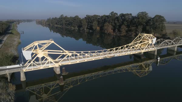 Reflection of Cantilever Bridge in Sacramento River Royalty-free stock video