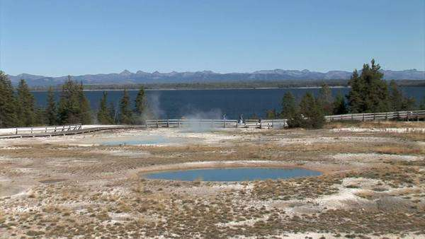 Visitors at Yellowstone Lake and Mineral Pools, wide shot, zoom Royalty-free stock video