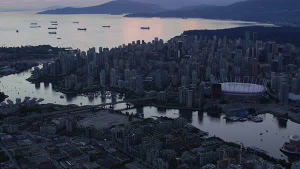 Aerial shot of modern crowded Vancouver cityscape with BC Place at dusk, British Columbia, Canada Rights-managed stock video