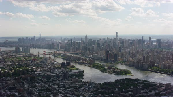 Aerial shot of Roosevelt Island with Queensboro Bridge Rights-managed stock video