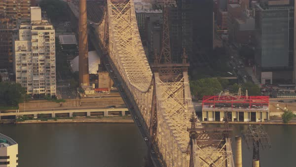 Zooming in shot of Queensboro Bridge over East River Rights-managed stock video