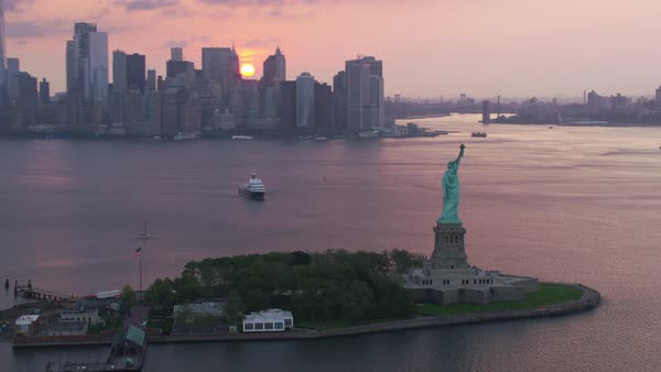 Aerial shot of Statue of Liberty with New York City skyline in background Rights-managed stock video