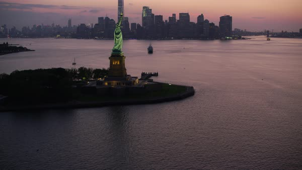 Aerial shot of Manhattan skyline with Statue of Liberty Rights-managed stock video