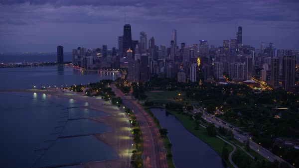 Aerial shot of skyscrapers on shore of Lake Michigan in Chicago Rights-managed stock video
