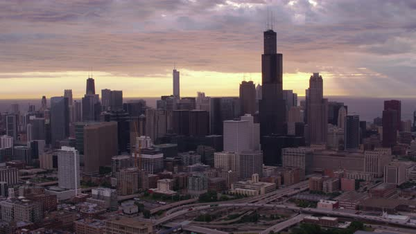 Aerial shot of downtown Chicago cityscape with sunrise over Lake Michigan Rights-managed stock video