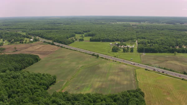 Aerial shot of a forested flatland Rights-managed stock video
